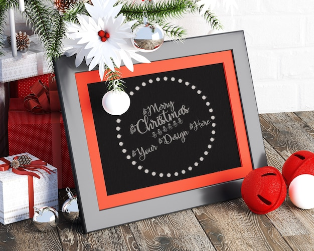 Small picture frames next to the gift boxes christmas mockup