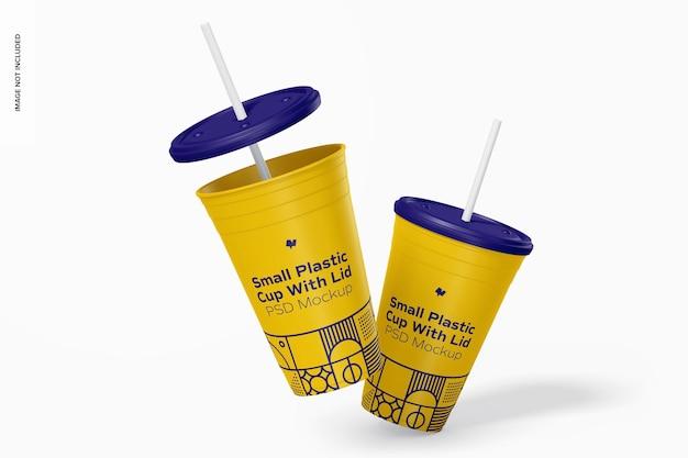Маленький пластиковый стаканчик с крышкой, макет, падающий
