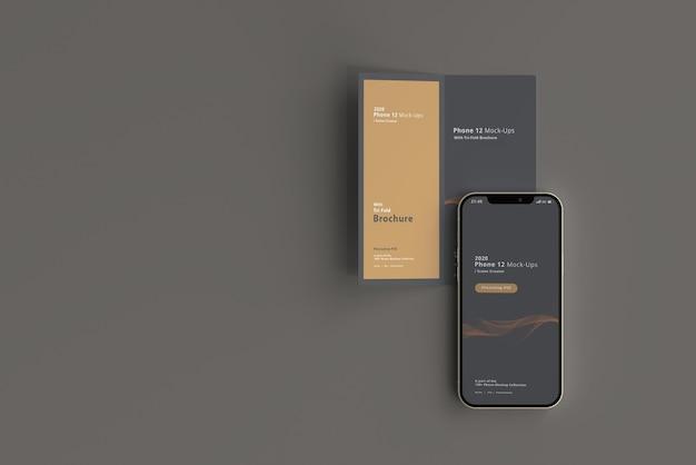 Smart phone mockup with bi-fold brochure
