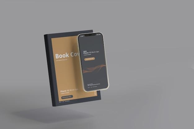 Мокап смартфона с книгой в твердом переплете