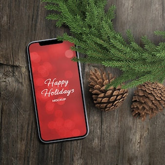 Smart phone screen online promo sale mockup for holiday concept with christmas decoration isolated