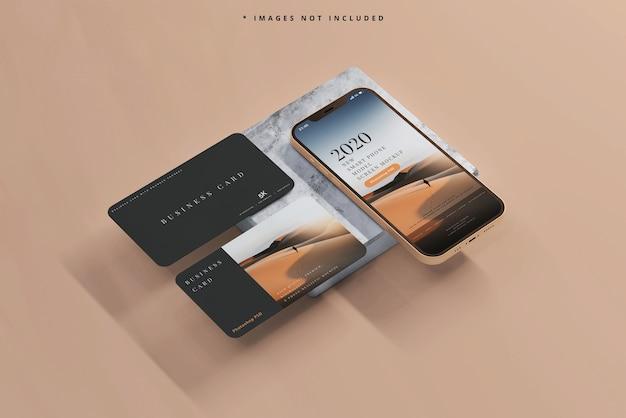 Smartphone e tablet con mockup di biglietti da visita