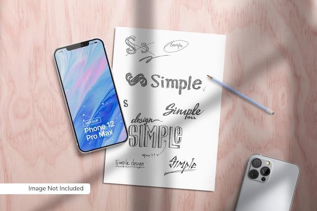 スマートフォン12promaxと紙のモックアップ