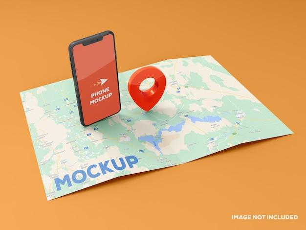 지도 모형에 스마트 폰 및 빨간색 gps 핀