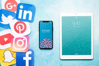 Smartphone and tablet mockup with social media concept