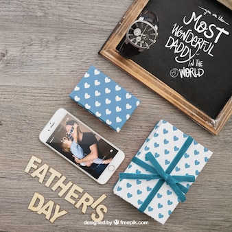 Smartphone, chalkboard and gift boxes for father's day