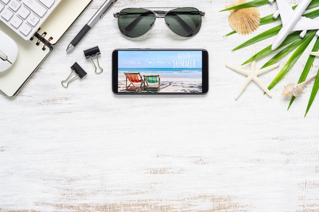 Smartphone mock up template with summer beach planning travel concept.