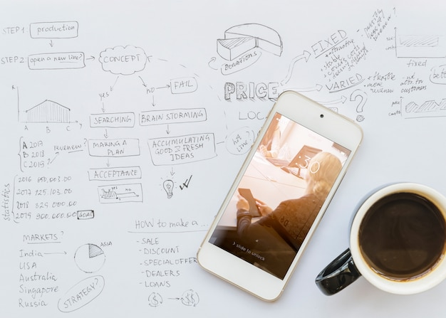Smartphone mockup on business drawing