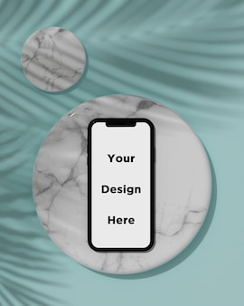 Макет смартфона на мраморной текстуре с 3d визуализацией тени тропического дерева