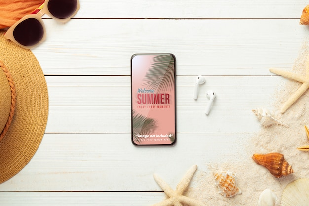 Smartphone mockup screen with beach accessories and earphones, top view