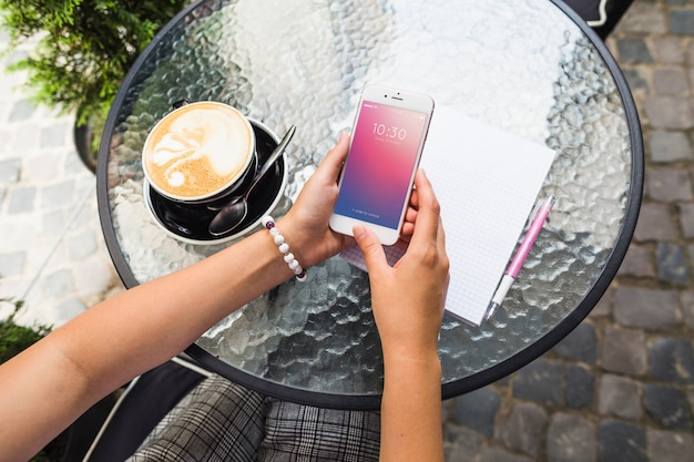 Smartphone mockup on table with cappuchino