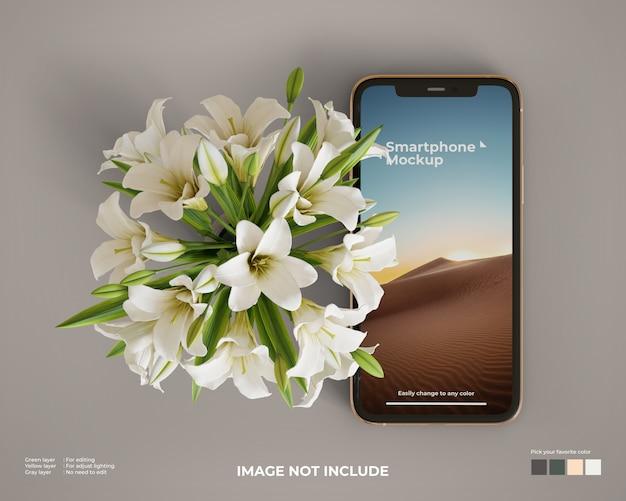 側に花を持つスマートフォンのモックアップ