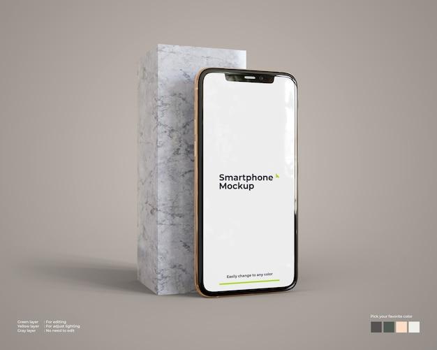 大理石ブロック付きスマートフォンのモックアップ