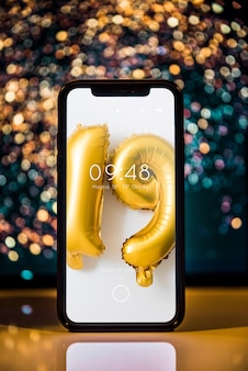 Smartphone mockup with new year decoration
