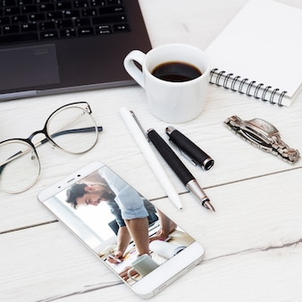 Smartphone mockup with office elements