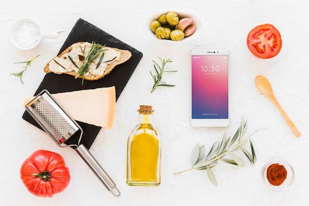 Смартфонный макет с концепцией оливкового масла