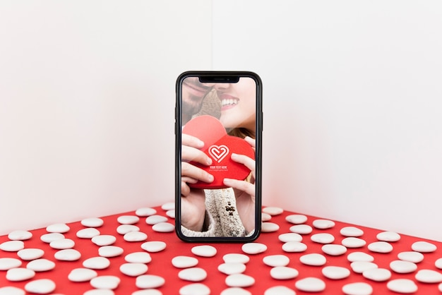 Smartphone mockup with valentine concept