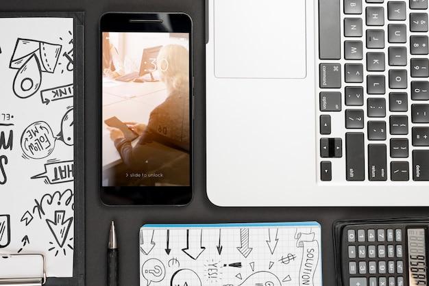 Smartphone mockup on workspace