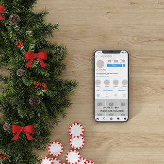 Smartphone screen mockup beside christmas decorationc