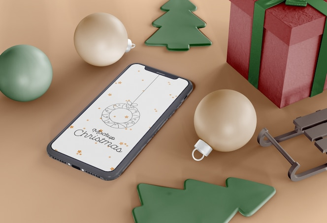 Smartphone with holiday ornaments mockup