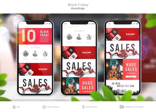 ブラックフライデーの販売のための店のテーブルのスマートフォンのモックアップ