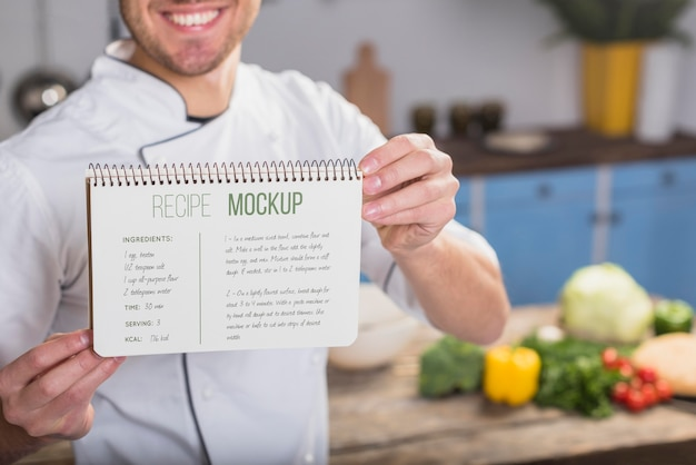 Smiley chef holding a recipe mock-up