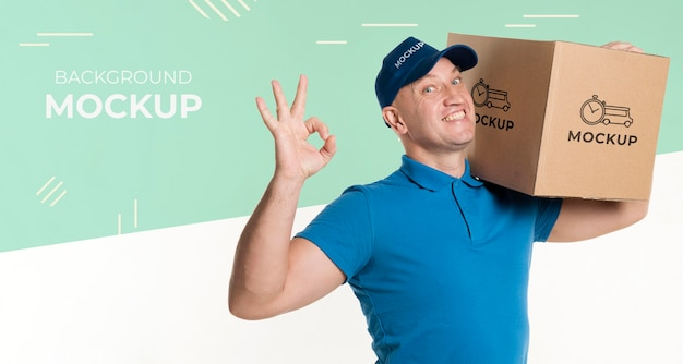 Smiley delivery man holding a box