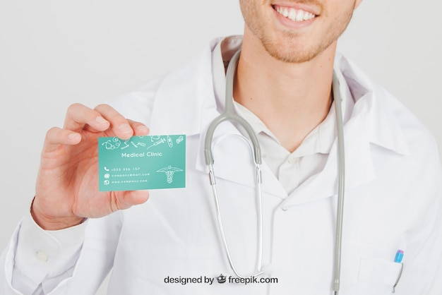 Smiley doctor with mock up of visit card