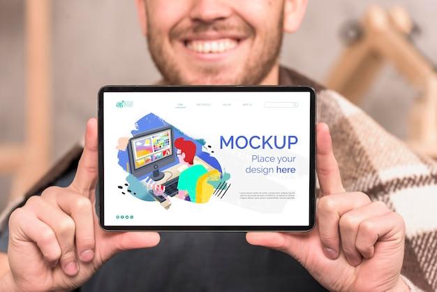 Smiley man showing tabletdigital mock-up