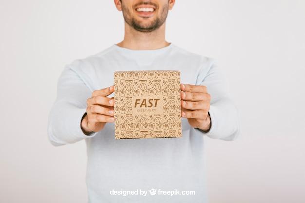 Smiley man with carton box
