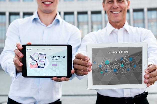 Smiley men holding digital devices for internet marketing