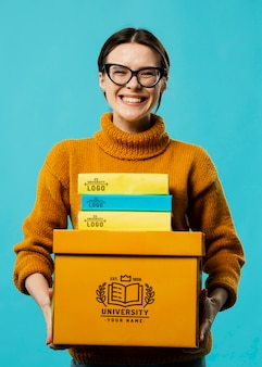 Smiley woman holding boxes