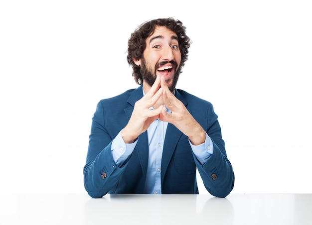 Smiling man with fingers together