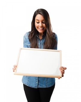 Smiling student looking at a blank board