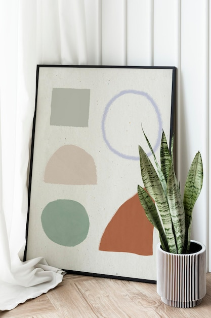 Snake plant in a gray plant pot by a picture frame mockup