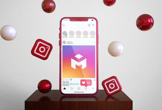 携帯電話のモックアップ上のソーシャルメディアinstagram