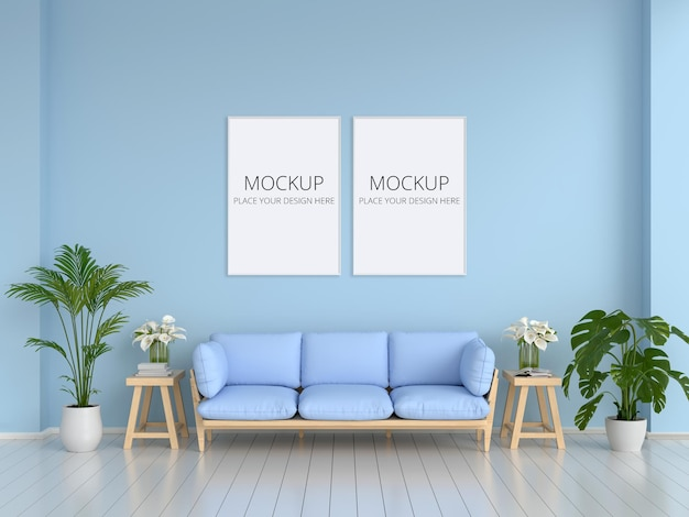 Sofa and plant in blue living room with frames mockup