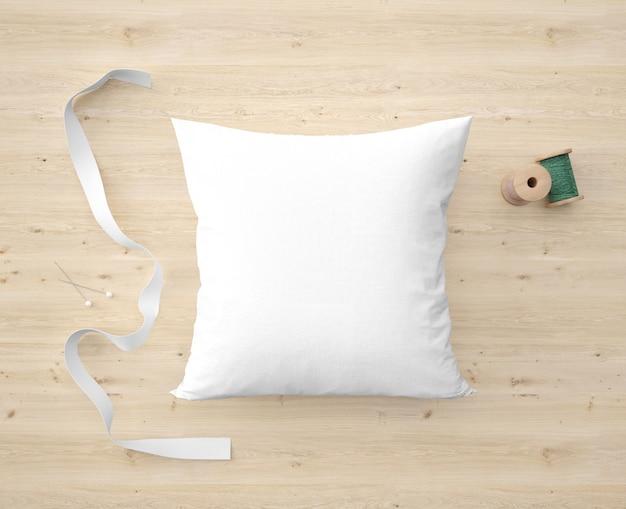 부드러운 흰색 베개, 리본 및 녹색 실