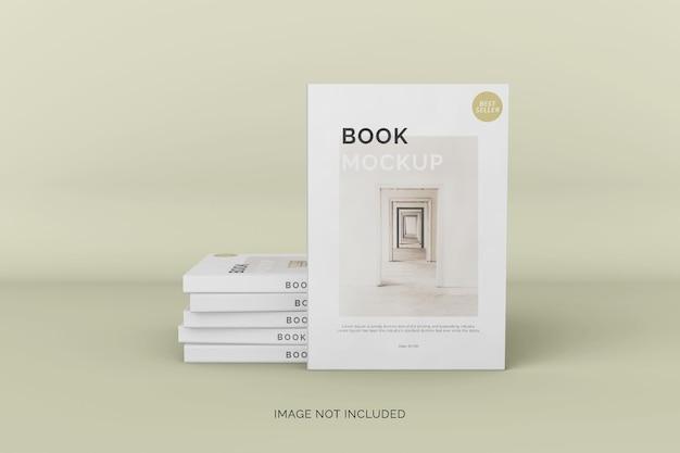 Вид спереди макета книги в мягкой обложке и стопка книг