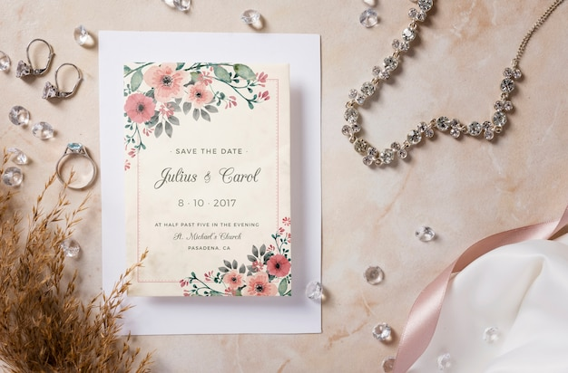 Special arrangement of wedding elements with invitation mock-up