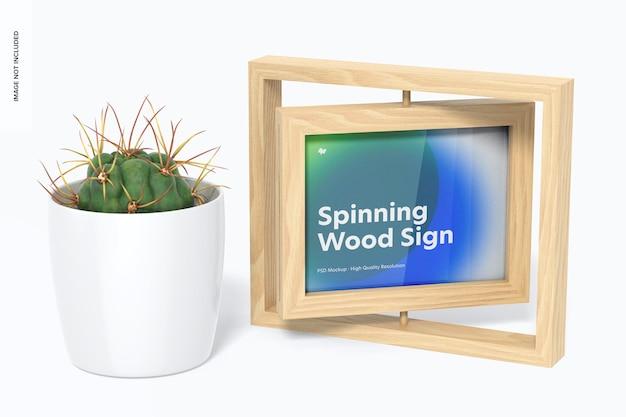 ポット植物のモックアップとスピニングウッドフレームサイン