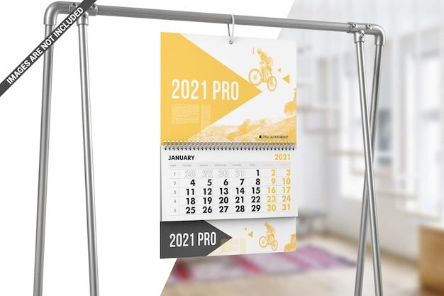 Spiral calendar hanging on metal stand mockup