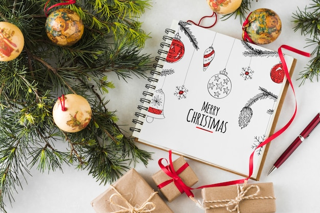 Spiral notebook mockup with christmas concept