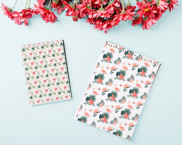 Spiral notepad mockup with flowers on top