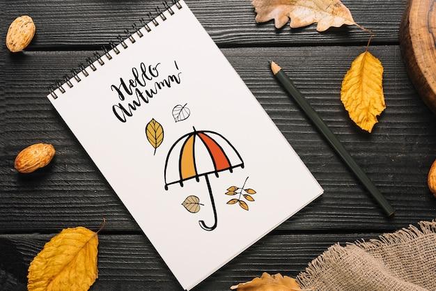 Спиральный макет блокнота с концепцией привет осень