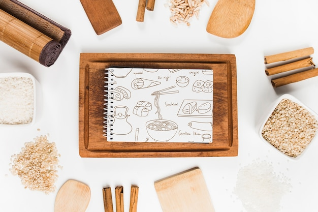 Spiral notepad mockup with japanese food mockup