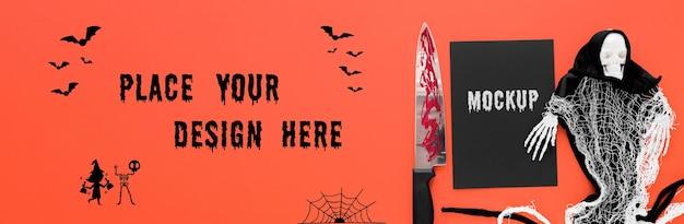 Disposizione spettrale di halloween con il coltello
