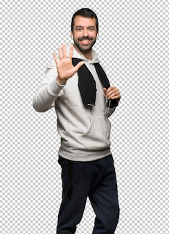 Sport man counting five with fingers