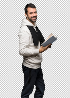 Sport man holding a book and enjoying reading