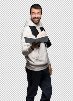 Sport man holding a book and giving it to someone